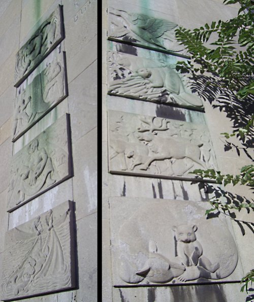 Concrete reliefs on each side of the main entrance